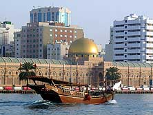 United Arab Emirates/Sharjah: 'Sharjah Museum of Islamic Civilization' with golden dome and dhow in Sharjah Creek
