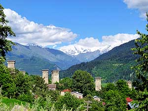 Georgia: Defence towers and Caucasus snow mountains before Mestia in Svaneti