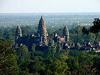 Cambodia: Main temple of Angkor Wat with its five towers viewed from the hill of the 'Phnom Bakheng'-Temple