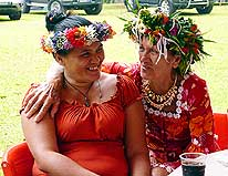 Tahiti/French Polynesia: Tahitiens with fresh traditional flower wreath handmade