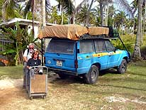 Tonga/Tongatapu: Liliana with crutches and the 'trolley' on the way to the doctor, while the LandCruiser is banned from driving