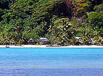 Samoa/Upolu: Typical beach with 'Fales' on the island of Namua in the East of Upolu